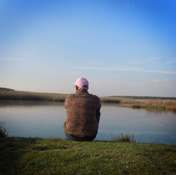 photo of wild artistic photographer sitting by a lake